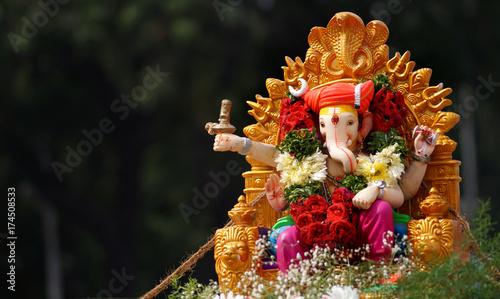 Hindu devotees bring Ganesha Idol for immersion in water body on 11th day of Ganesha Chathurthi festival celebration,annual ritual