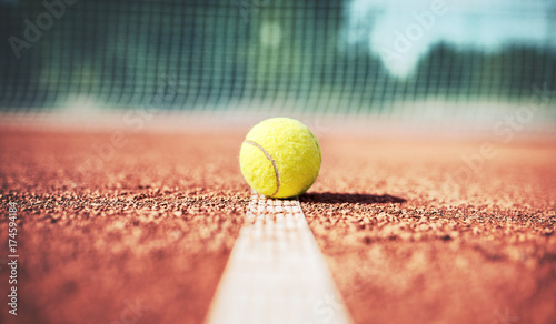 Tennis ball on the tennis court. Sport, recreation concept