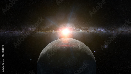 sunrise over planet Mercury lit by the Sun and the Milky Way galaxy