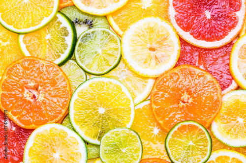 Leinwand Poster Citrus fruits various top view background. Vitamin c fruits.