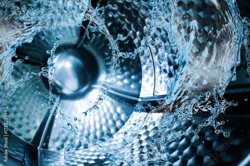 Obraz na plátně Water splash of the washing machine drum