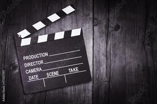 Movie clapper board on wooden background Fototapeta
