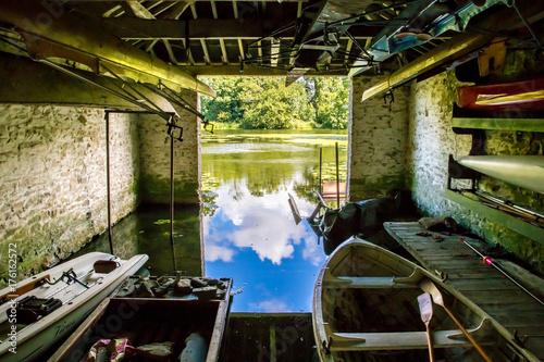 Leinwand Poster Inside of old boat house on Shropshire lake