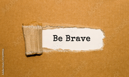 Canvas Print The text Be Brave appearing behind torn brown paper