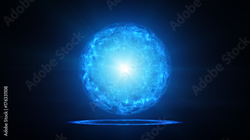 Photo Blue plasma ball with energy charges in studio