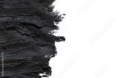 Fotografia Black volcanic cosmetic clay texture close up