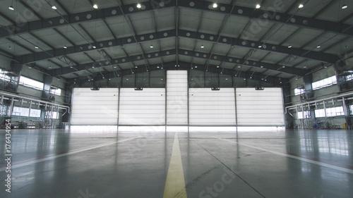 Obraz na płótnie Roller shutter door and concrete floor inside factory building for industrial background