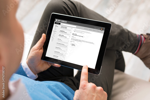 Man reading email on tablet