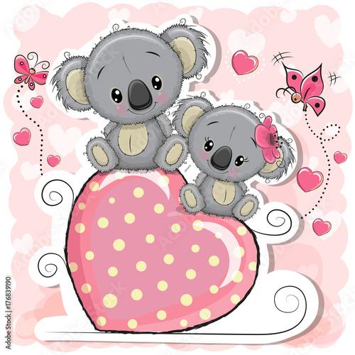 Fototapeta premium Two Koalas is sitting on a heart