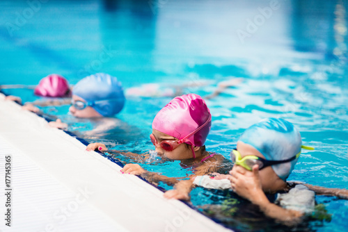 Group of children on swimming class