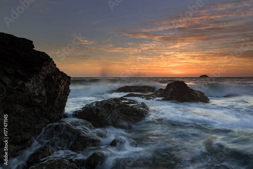 moving water with a cloudy sunrise sky