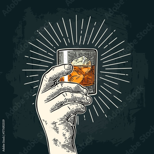 Slika na platnu Male hand holding glass whiskey with ray