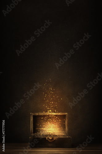 Fototapeta Opened Treasure Chest Releasing Glowing Sparkles and Stars