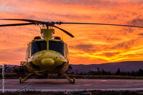 Obraz na plátně Helicopter on a sunset