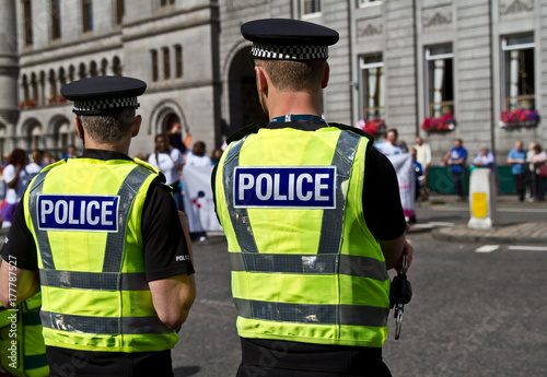 Photo Police officers watching the crowd. UK Police