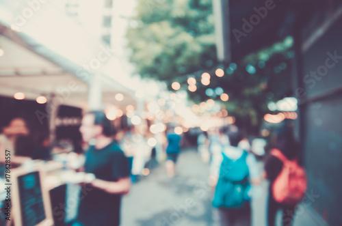 Tablou Canvas blurred night market festival people walking on road