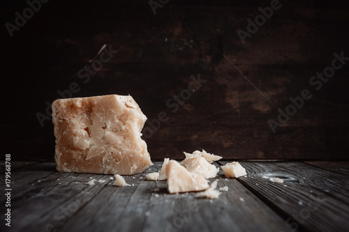 Italian hard cheese  on the old wooden table