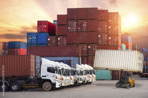 Wallpaper Mural Industrial crane loading container to truck for Logistic Import Export backgroun