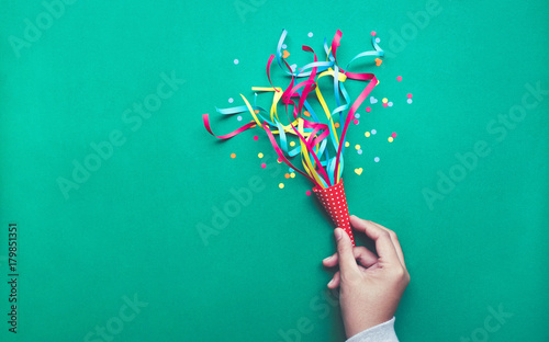 Leinwand Poster Celebration,party backgrounds concepts ideas with hand holding colorful confetti,streamers