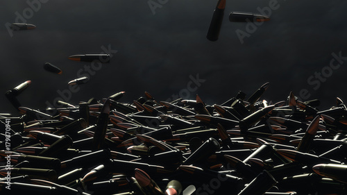 Fotografia Many bullets fall on the table. In the background a dark wall