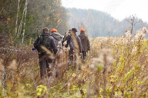 Fototapeta group of hunters during hunting in forest, chase hunting