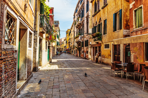 Narrow street in the old town in Venice Italy