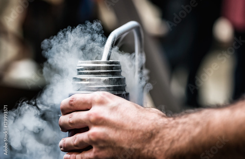 Filling the thermos with liquid nitrogen