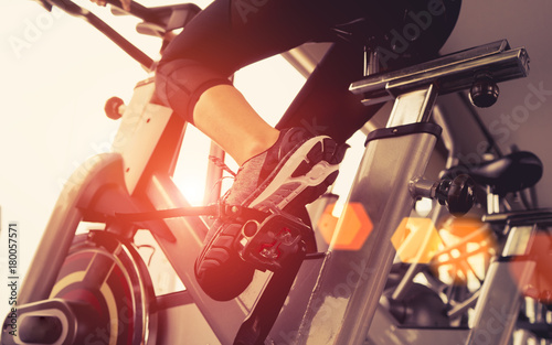 Fotografie, Obraz Exercise bicycle cardio workout at fitness gym taking weight loss