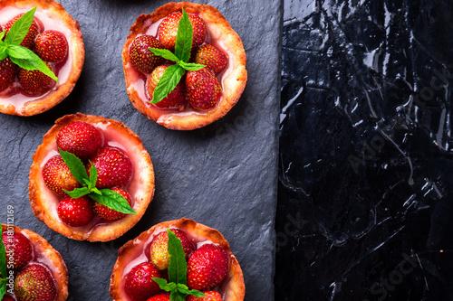 Homemade strawberries tarts on slate plate, black background Tapéta, Fotótapéta