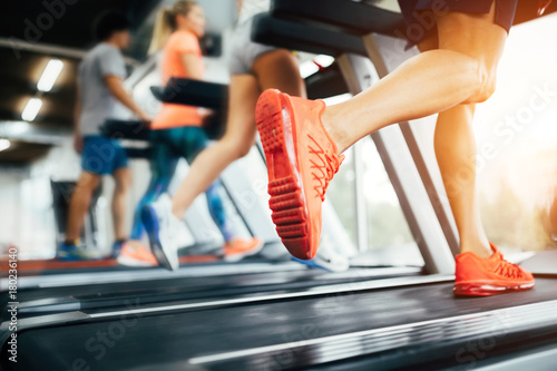 Picture of people running on treadmill in gym Fototapeta