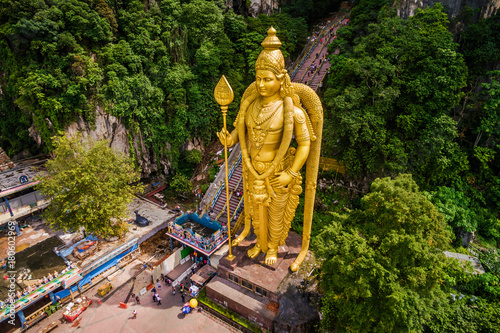 Batu Caves near Kuala Lumpur, Malaysia, aerial view of Lord Murugan Statue and entrance to the famous cave temples.