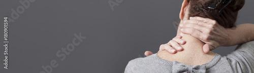 Fotografie, Obraz self-acupressure for relaxing shoulder and backache, grey long panorama