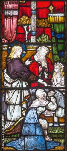 Fotografia, Obraz LONDON, GREAT BRITAIN - SEPTEMBER 19, 2017: The Raising of Jairus Daughter on the stained glass in St Mary Abbot's church on Kensington High Street