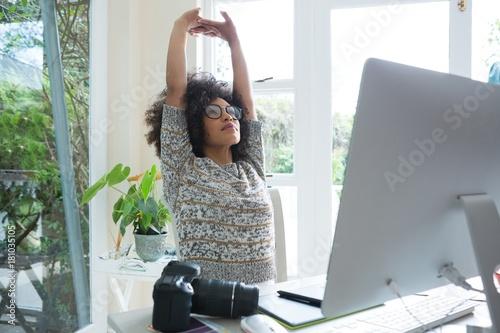 Fotografia Graphic designer stretching her arms