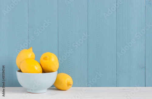 Plate with fresh lemons on the table