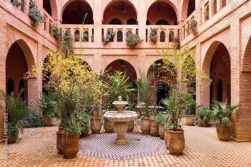 Canvas Print beautiful garden inside moroccan courtyard, marrakech