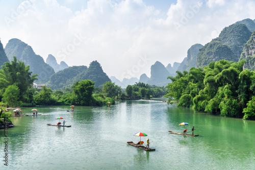 Stampa su Tela View of tourist bamboo rafts sailing along the Yulong River