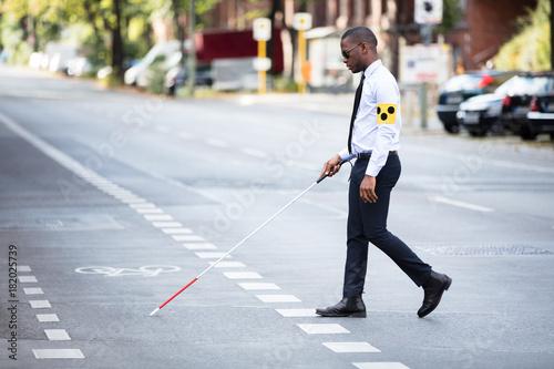 Fotografie, Tablou Blind Man Wearing Armband Walking With Stick