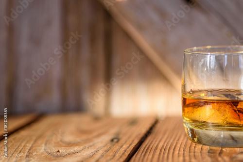 Slika na platnu single glass of bourbon on the rocks