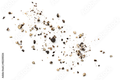 Crushed Black Peppercorns Scattered on White Background