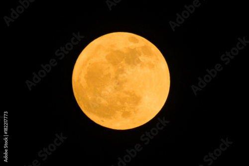 the detail of yellow full moon on black background, zoom image