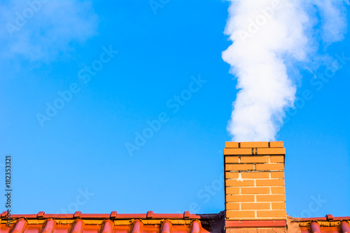 Modern house roof with chimney smoke, air pollution and smog in winter, ecologic Fototapet