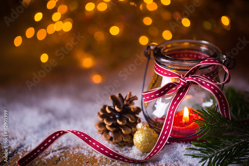 Canvas Advent, Christmas  -  Burning candle in snow landscape with bokeh background