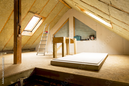 house attic under construction mansard wall insulation with rock wool