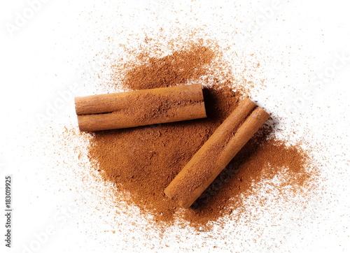 Valokuvatapetti cinnamon sticks with powder isolated on white background
