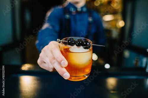 Obraz na plátně Bartender is making cocktail at bar.