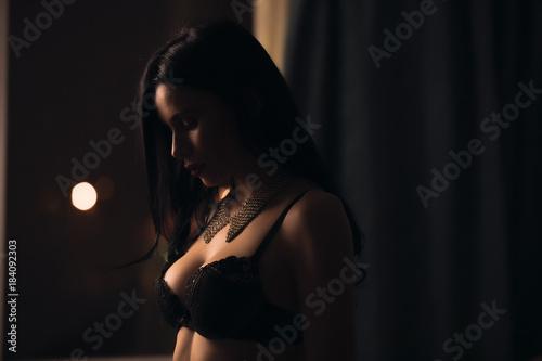 Valokuvatapetti Sexy brunette woman in lingerie portrait at dark home room