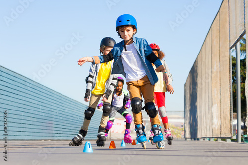 Kids learning to avoid cones at slalom course