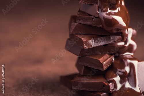 Canvas Print melted chocolate pouring into a piece of chocolate bars