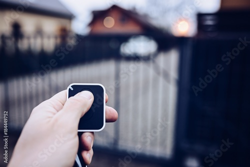 Fotografía Man opening automatic property gate